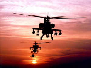 helicopters in sunset